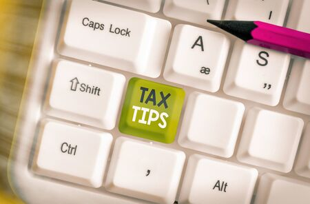 Handwriting text writing Tax Tips. Conceptual photo compulsory contribution to state revenue levied by government 写真素材