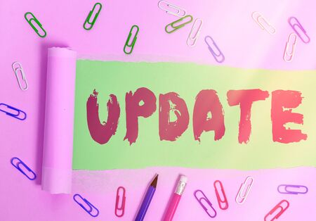 Writing note showing Update. Business concept for by adding new information or making corrections Up to date Фото со стока