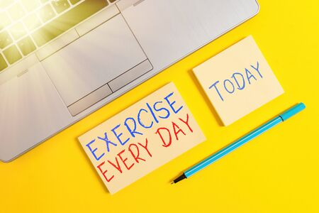 Text sign showing Exercise Every Day. Business photo text move body energetically in order to get fit and healthy Trendy silver open laptop square sticky notepads marker colored background