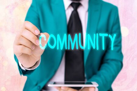 Word writing text Community. Business photo showcasing specific population with a common characteristics living together Banque d'images