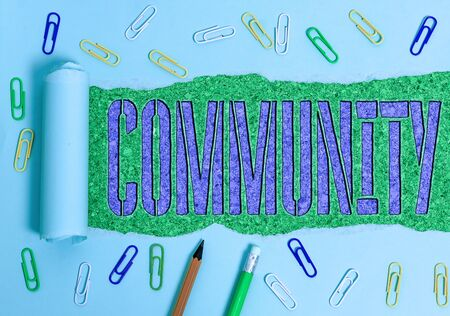 Conceptual hand writing showing Community. Concept meaning specific population with a common characteristics living together Banque d'images