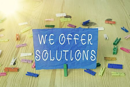 Writing note showing We Offer Solutions. Business concept for way to solve problem or deal with difficult situation