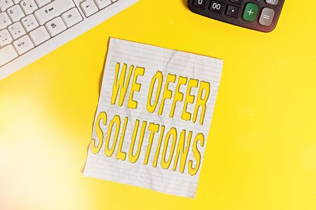 Conceptual hand writing showing We Offer Solutions. Concept meaning way to solve problem or deal with difficult situation Copy space on notebook with pc keyboard on the table 写真素材