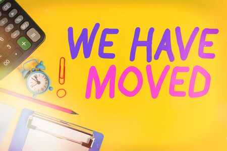 Text sign showing We Have Moved. Business photo showcasing To go from one residence or location to another Relocate Clock clips crushed note calculator pencil clipboard band color background