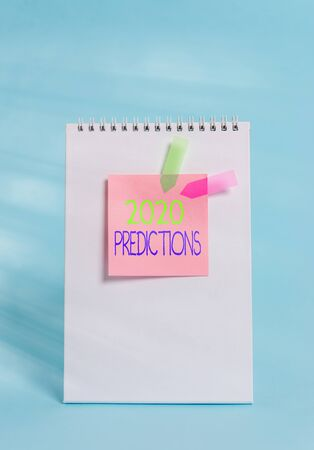 Handwriting text 2020 Predictions. Conceptual photo statement about what you think will happen in 2020 Standing spiral blank notebook sticky note banners cool pastel background