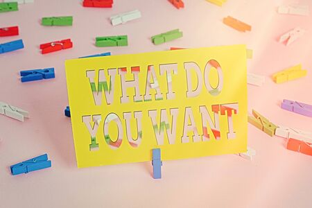 Text sign showing What Do You Want. Business photo text used for offering something to someone or asking their need Colored clothespin papers empty reminder pink floor background office pin