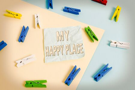 Handwriting text My Happy Place. Conceptual photo something nice has happened or they feel satisfied with life Colored clothespin paper empty reminder yellow blue floor background office