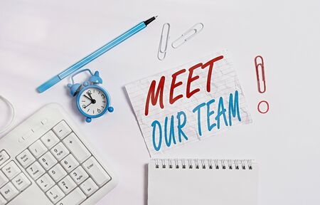 Handwriting text writing Meet Our Team. Conceptual photo introducing another an individual to your team mates in the company Copy space on the empty note paper with pc keyboard clock and pencil