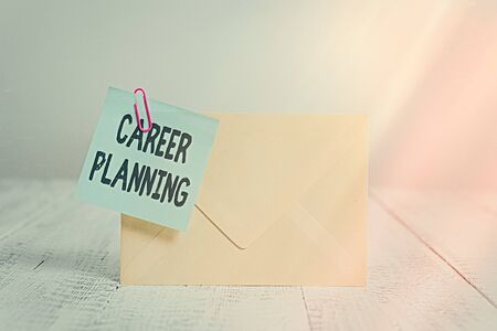 Text sign showing Career Planning. Business photo text Strategically plan your career goals and work success Standing rectangular colored envelope sticky note clip wooden background Stock fotó