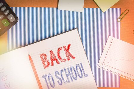 Text sign showing Back To School. Business photo text is the period relating to the start of a new school year Striped paperboard notebook cardboard office study supplies chart paper Stock fotó