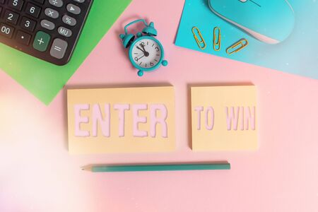 Handwriting text Enter To Win. Conceptual photo exchanging something value for prize or chance of winning Wire mouse clock calculator notepads marker sheets clips color background