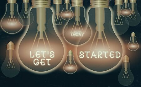 Writing note showing Let S Get Started. Business concept for encouraging someone to begin doing something