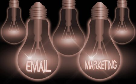 Writing note showing Email Marketing. Business concept for attracting potential buyer by communicating through the message Stock Photo