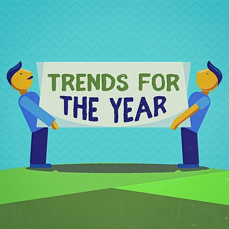Text sign showing Trends For The Year. Business photo text fashion styles or preferences for a period of time Two Men Standing Carrying Rectangular Blank Panel Board on Both Sides