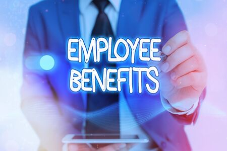 Writing note showing Employee Benefits. Business concept for form of compensation paid by employers to workers