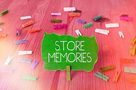 Writing note showing Store Memories. Business concept for a process of inputting and storing data previously acquired