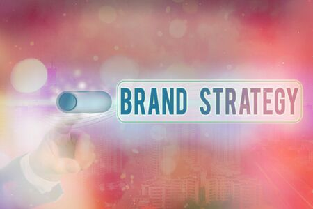 Conceptual hand writing showing Brand Strategy. Concept meaning longterm plan executed for the development of a good product