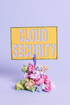 Text sign showing Cloud Security. Business photo showcasing Imposing a secured system of existing data in the Internet Reminder pile colored crumpled paper clothespin reminder blue background