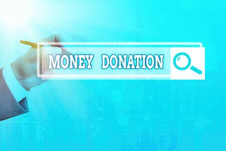 Text sign showing Money Donation. Business photo showcasing a charity aid in a form of cash offered to an association Reklamní fotografie
