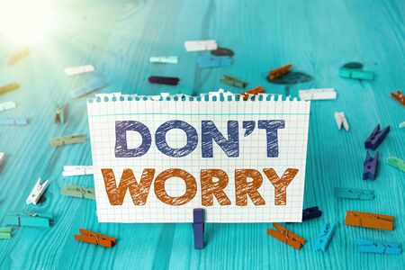 Writing note showing Do not dont Worry. Business concept for indicates to be less nervous and have no fear about something