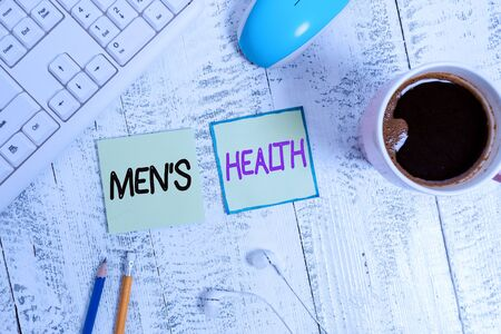 Handwriting text writing Men S Health. Conceptual photo men s is state of complete physical, mental, and social wellbeing Writing equipment and computer stuff plus drinks placed above wooden table Imagens