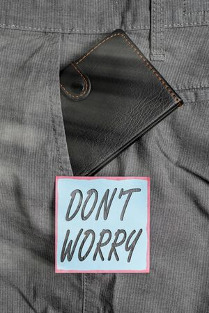 Writing note showing Do not dont Worry. Business concept for indicates to be less nervous and have no fear about something Small wallet inside trouser front pocket near notation paper Stok Fotoğraf