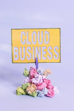 Text sign showing Cloud Business. Business photo showcasing internetbased delivery of services made available to users Reminder pile colored crumpled paper clothespin reminder blue background Stok Fotoğraf