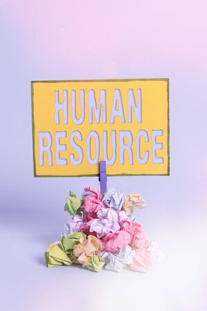 Text sign showing Human Resource. Business photo showcasing a critical department handling the staffing and employees concern Reminder pile colored crumpled paper clothespin reminder blue background Stockfoto