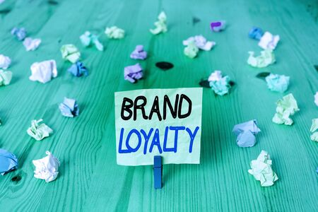 Conceptual hand writing showing Brand Loyalty. Concept meaning positive feelings to a brand and purchase the same product