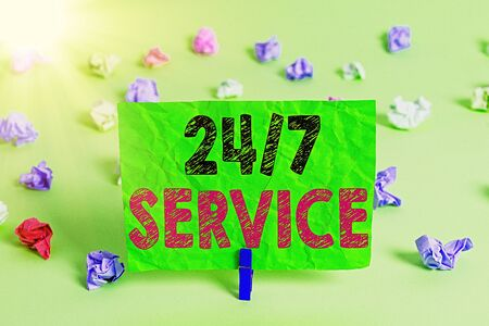 Writing note showing 24 Or7 Service. Business concept for providing an assistance that is available all the time 写真素材