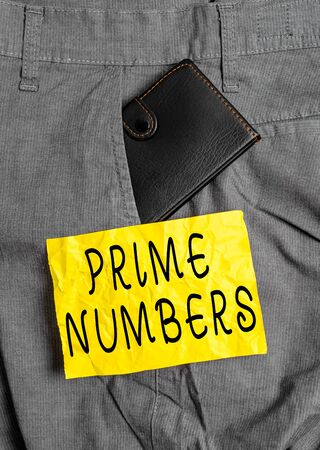 Word writing text Prime Numbers. Business photo showcasing a positive integer containing factors of one and itself Small little wallet inside man trousers front pocket near notation paper