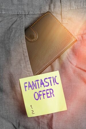 Writing note showing Fantastic Offer. Business concept for a marketing strategy which helps in captivating more customers Small wallet inside trouser front pocket near notation paper