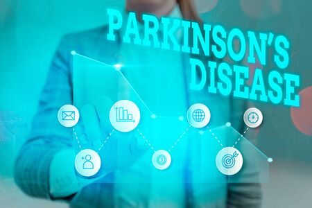 Writing note showing Parkinsons Disease. Business concept for chronic progressive neurological disease of later life 版權商用圖片