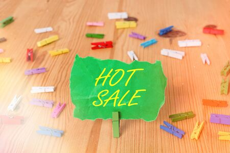 Word writing text Hot Sale. Business photo showcasing a very good discount of items is displayed over a limited time Colored clothespin papers empty reminder wooden floor background office