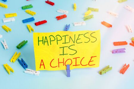 Handwriting text writing Happiness Is A Choice. Conceptual photo Stay happy no matter what Inspired Motivated Colored clothespin papers empty reminder blue floor background office pin
