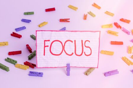 Conceptual hand writing showing Focus. Concept meaning to give attention to one particular thing make do concentrate Colored clothespin papers empty reminder white floor office Stock Photo