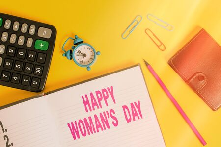 Handwriting text Happy Woman S Day. Conceptual photo to commemorate the essence of every lady around the world Open notebook wallet calculator clips pencil alarm clock color background