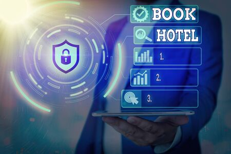 Handwriting text Book Hotel. Conceptual photo reserving an accommodation paid on a shortterm basis in advance Banque d'images - 149397020