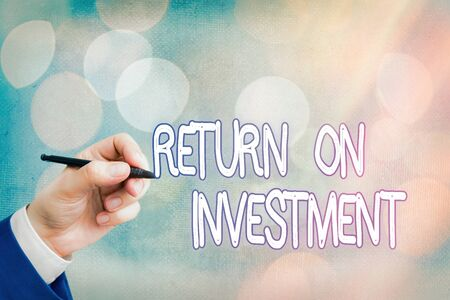Conceptual hand writing showing Return On Investment. Concept meaning reviewing a financial report or investment risk analysis