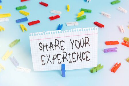 Writing note showing Share Your Experience. Business concept for tell us your story including ideas and feelings run into Colored clothespin papers empty reminder blue floor officepin
