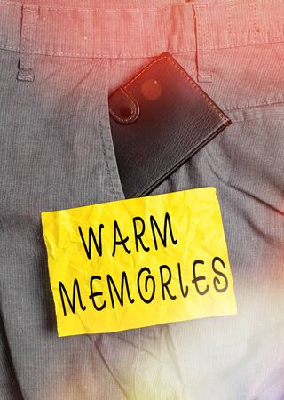 Word writing text Warm Memories. Business photo showcasing reminiscing the unforgettable collection of past events Small little wallet inside man trousers front pocket near notation paper