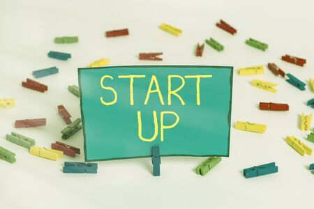 Word writing text Start Up. Business photo showcasing in the early process of establishing and developing a new business Colored clothespin papers empty reminder white floor background office