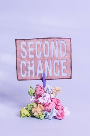 Word writing text Second Chance. Business photo showcasing the opportunity given to someone, allows them to try again Reminder pile colored crumpled paper clothespin reminder blue background Stockfoto