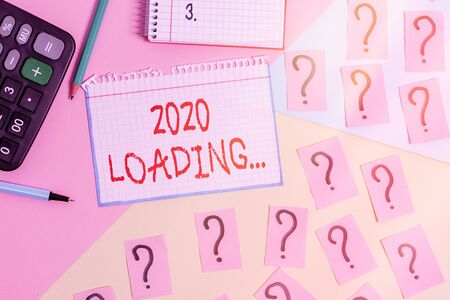Writing note showing 2020 Loading.... Business concept for a year composed of a series of events that are still ongoing Mathematics stuff and writing equipment above pastel colours background