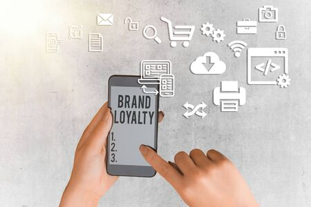 Writing note showing Brand Loyalty. Business concept for positive feelings to a brand and purchase the same product