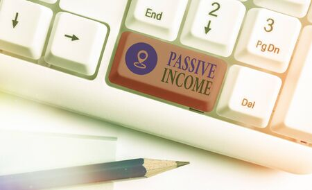 Text sign showing Passive Income. Business photo showcasing earnings extracted from rental property, and other enterprises Stok Fotoğraf