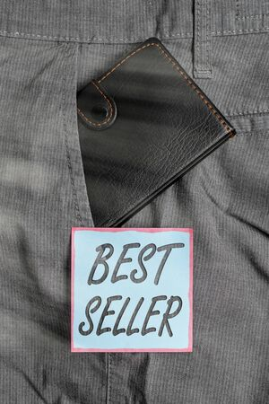 Writing note showing Best Seller. Business concept for a highlypurchased commodity produced in large amounts Small wallet inside trouser front pocket near notation paper