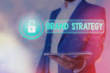 Text sign showing Brand Strategy. Business photo showcasing longterm plan executed for the development of a good product Stock Photo