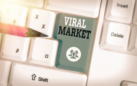 Writing note showing Viral Market. Business concept for network passing and spreading message or video on product or service