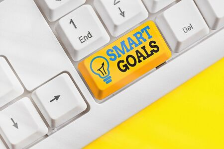 Conceptual hand writing showing Smart Goals. Concept meaning mnemonic used as a basis for setting objectives and direction 스톡 콘텐츠